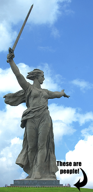 This is a photo of the  'Motherland Calling' monument. It is a woman holding an upraised sword. It stands in the Russian city of Volgograd, formerly Stalingrad.